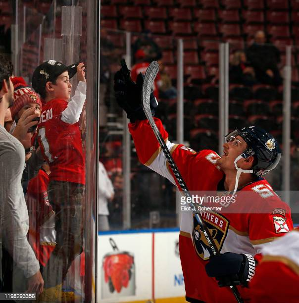 Noel Acciari of the Florida Panthers flips a puck to fans during warm ups prior to the start of the game against the Arizona Coyotes at the BB&T...