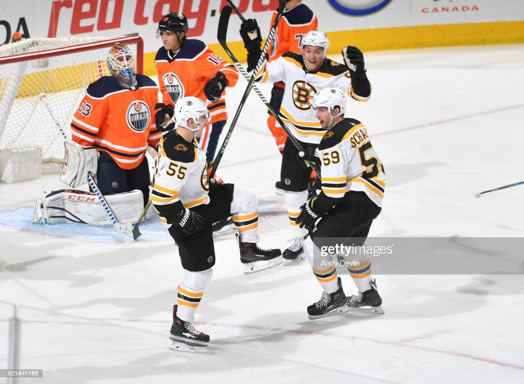 Noel Acciari #55, Tim Schaller #59 and Sean Kuraly #52 of the Boston Bruins celebrate after a goal during the game against the Edmonton Oilers on February 20, 2018 at Rogers Place in Edmonton, Alberta, Canada.