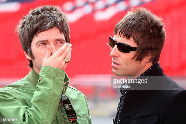 Noel and Liam Gallagher attend the Oasis photocall in Wembley Stadium to promote their new album 'Dig out Your Soul' released on October 6 and their...