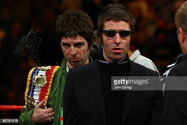 Noel and Liam Gallagher of Oasis bring out boxer Ricky Hatton of England's belts before taking on Paulie Malignaggi during their lightwelterweight...
