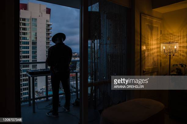 Noel Brandon known as DJ IAMNOEL gets ready to play his set on a balcony in downtown San Diego California on April 11 2020 NOEL was inspired by other...