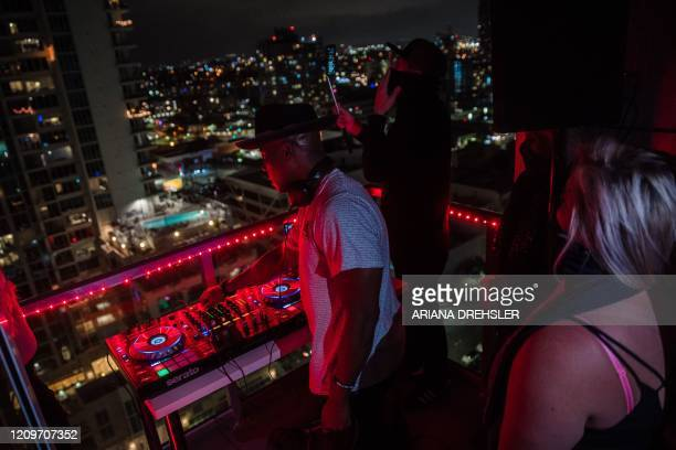 Noel Brandon known as DJ IAMNOEL plays his set on a balcony in downtown San Diego California on April 11 2020 NOEL was inspired by other countries...