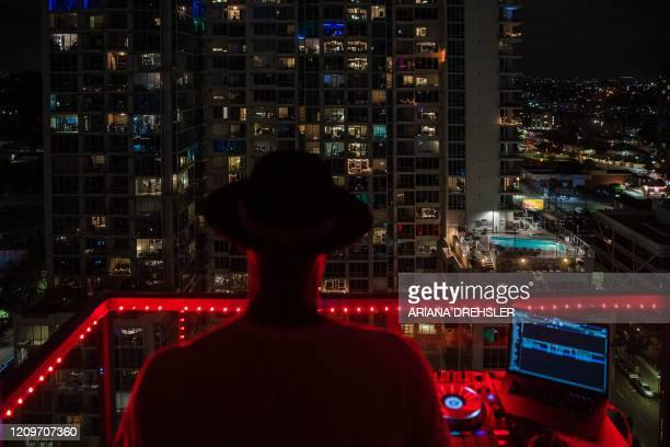 TOPSHOT Noel Brandon known as DJ IAMNOEL plays his set on a balcony in downtown San Diego California on April 11 2020 NOEL was inspired by other...
