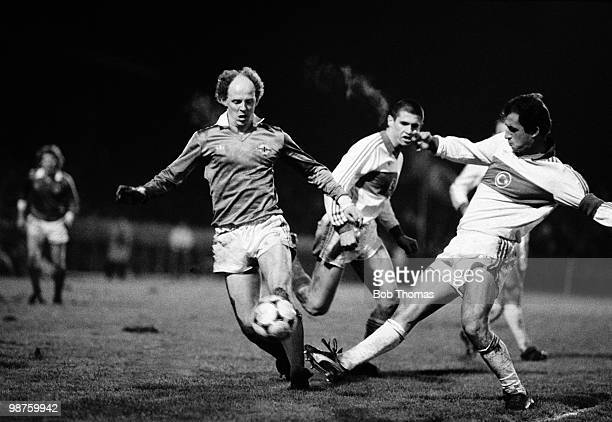 Noel Brotherston of Northern Ireland is tackled by Turkey captain Fatih as Hakan looks on during the European Championship qualifying match held at...