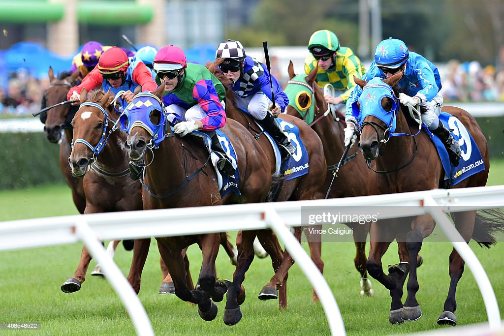 Noel Callow riding Bel Rhythm (R) winning Race 4, during Melbourne racing at Caulfield Racecourse on April 4, 2015 in Melbourne, Australia.
