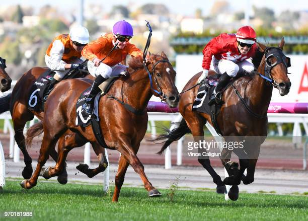 Noel Callow riding Remember the Name defeats Fred Kersley riding Absolute Heaven in Race 3 during Melbourne Racing at Flemington Racecourse on June 9...