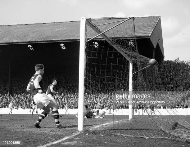 Noel Cantwell of Manchester United scores past Burnley goalkeeper Adam Blacklaw during a Football League Division One match at Turf Moor on April 14,...