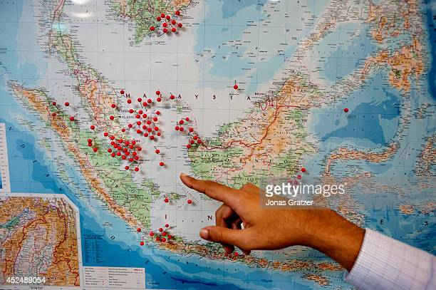Noel Choong points to a map inside the IMB's Piracy Reporting Centre to show where pirate attacks have been occurring in recent years The red pins...