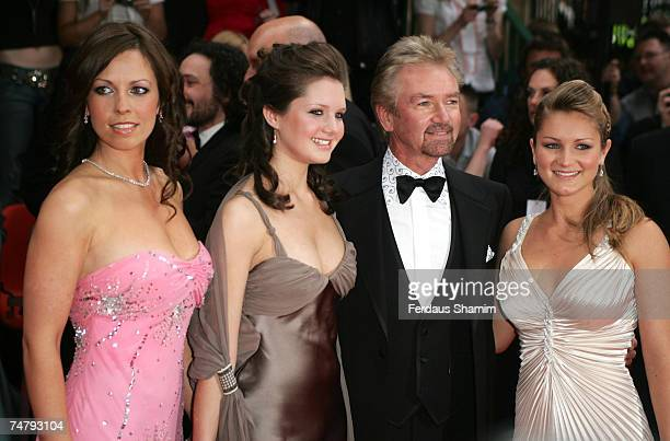 Noel Edmonds with Charlotte Lorna and Olivia at the Grosvenor House in London United Kingdom