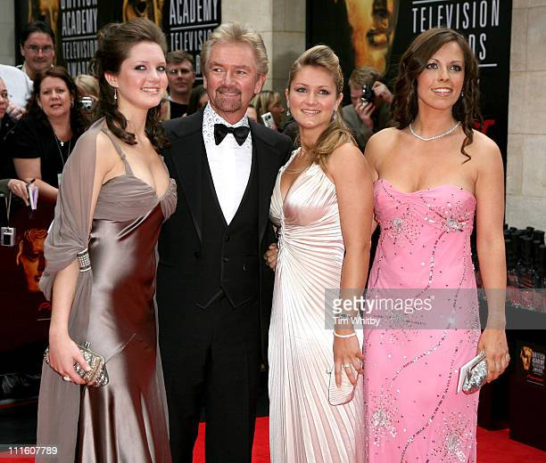 Noel Edmonds with Charlotte Lorna and Olivia during The 2006 British Academy Television Awards Arrivals at Grosvenor House in London Great Britain