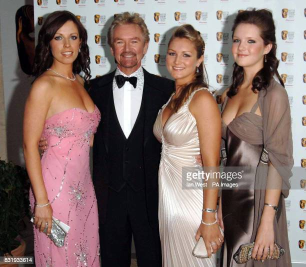 Noel Edmonds with his daughters Charlotte Lorna and Olivia arrive for the TV Baftas at the Grosvenor House Hotel in central London