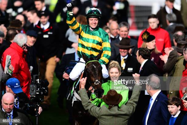 Noel Fehily on board Buveur D'air celebrates after winning the Stan James Champion Hurdle Challenge Trophy during Champion Day of the Cheltenham...