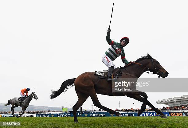 Noel Fehily on Unowhatimeanharry celebrates victory in the Albert Bartlett Novices' Hurdle as part of the Cheltenham Festival at Cheltenham...
