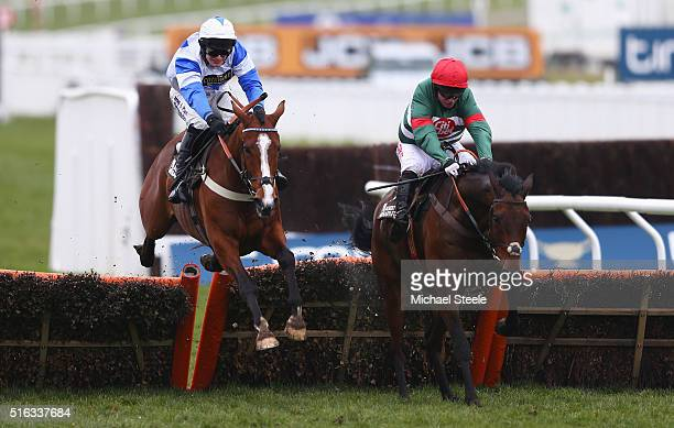 Noel Fehily on Unowhatimeanharry jumps on the way to winning the Albert Bartlett Novices' Hurdle as part of the Cheltenham Festival at Cheltenham...