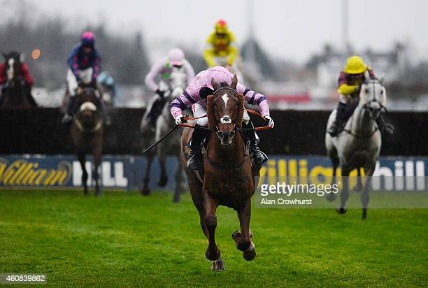 Noel Fehily riding Silviniaco Conti clears the last to win The William Hill King George VI Steeple Chase at Kempton Park racecourse on December 26...