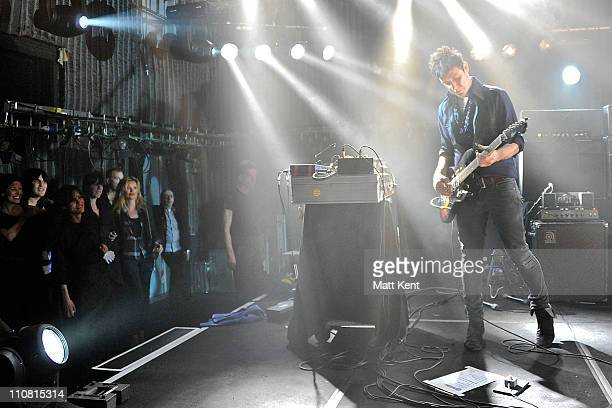 Noel Fielding and Kate Moss watch as Moss's fiance Jamie Hince of The Kills performs on stage at Barclaycard Mercury Prize Session at The Hospital...