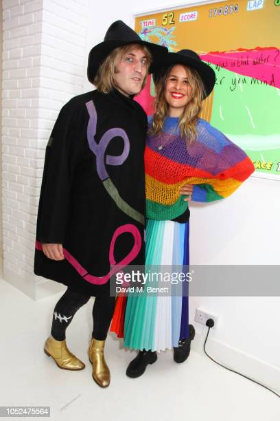 Noel Fielding and Lliana Bird attend a private view of Daft Apeth by Serge Pizzorno of Kasabian at No Ho Showrooms on October 18 2018 in London...