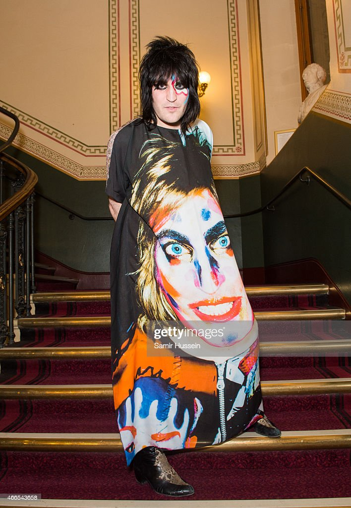 Noel Fielding and Lliana Bird attend a private view of the Noel Fielding art exhibition 'He Wore Dreams Around Unkind Faces' at the Royal Albert Hall on March 16, 2015 in London, England.