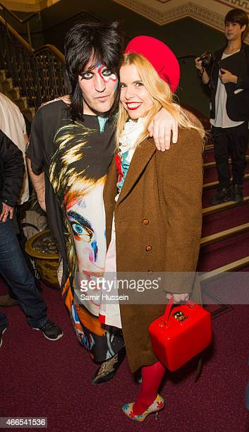 Noel Fielding and Paloma Faith attend a private view of the Noel Fielding art exhibition 'He Wore Dreams Around Unkind Faces' at the Royal Albert...