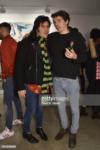 Noel Fielding and Tomo Campbell attend a private view of There by Tomo Campbell at The Cob Gallery on April 11 2018 in London England
