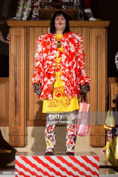 Noel Fielding walks the runway at the Bas Kosters show at London Fashion Week AW14 at The Dutch Centre on February 15 2014 in London England