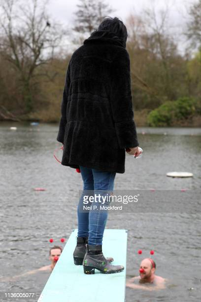 Noel Fielding watches Benedict Cumberbatch and Zander Woollcombe of United Global Mental Health support Red Nose Day by swimming in cold water for...