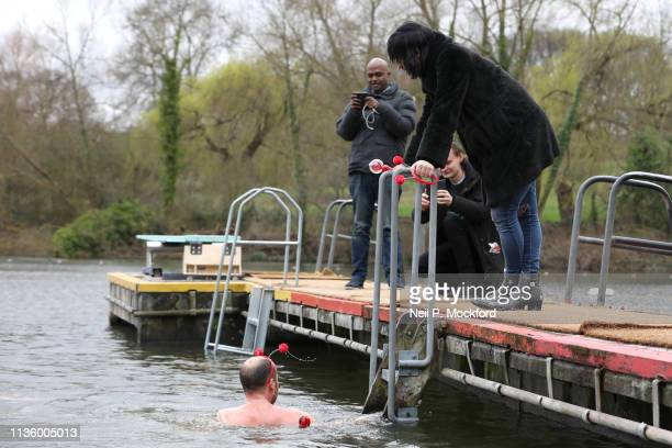 Noel Fielding watches Zander Woollcombe of United Global Mental Health support Red Nose Day by swimming in cold water for Mental Health programmes on...