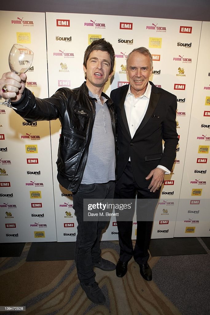 Noel Gallagher and CEO of EMI Roger Faxon attend The EMI Puma Cobra post BRIT awards party at the O2 on February 21, 2012 in London, England.
