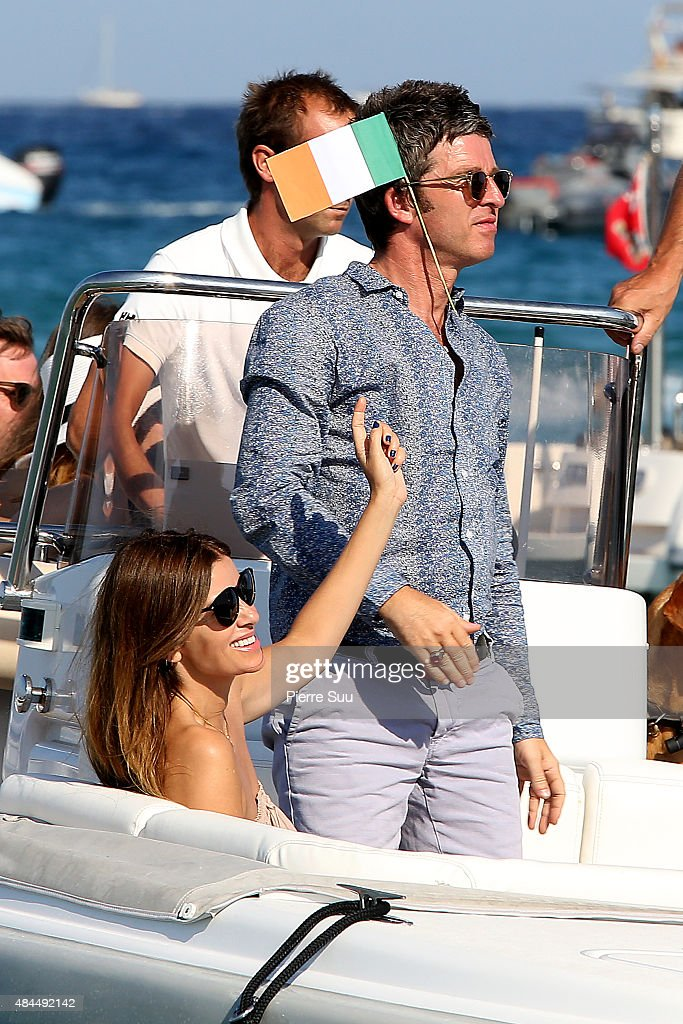 Noel Gallagher and his girlfriend Sarah Mc Donaldleave the 'Club 55' on August 19, 2015 in Saint-Tropez, France.