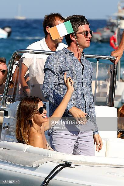 Noel Gallagher and his girlfriend Sarah Mc Donaldleave the 'Club 55' on August 19 2015 in SaintTropez France