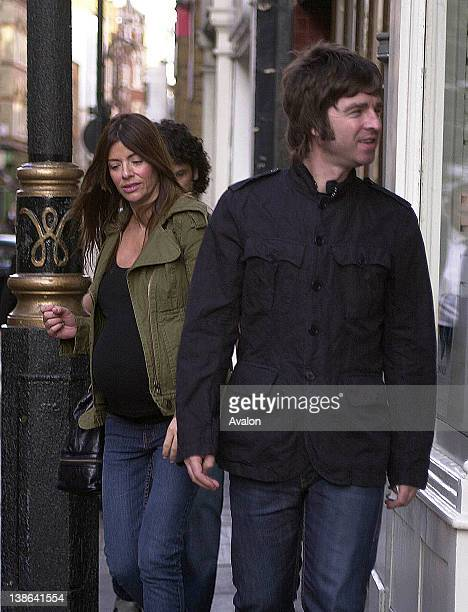 Noel Gallagher and his pregnant partner Sara MacDonald walking through Soho London 14th September 2007