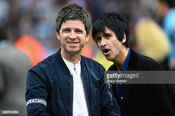 Noel Gallagher and Johnny Marr celebrate at the end of the Barclays Premier League match between Manchester City and West Ham United at the Etihad...