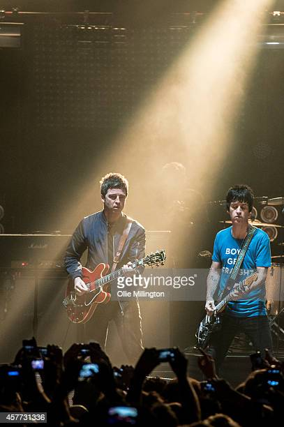 Noel Gallagher and Johnny Marr perform two songs together at the end of Johnny Marr's show at Brixton Academy on October 23 2014 in London England