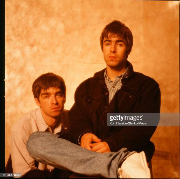 Noel Gallagher and Liam Gallagher of Oasis, at a photoshoot in a hotel in Tokyo, September 1994.