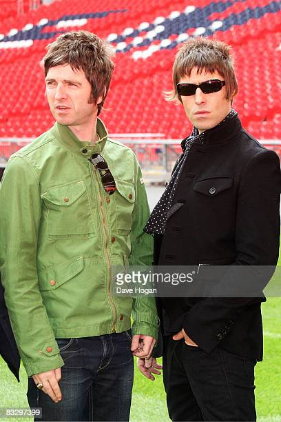 Noel Gallagher and Liam Galllagher attend the Oasis photocall in Wembley Stadium to promote their new album 'Dig out Your Soul' released on October 6...