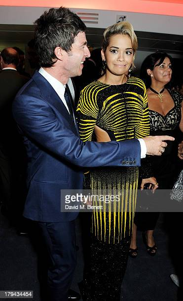 Noel Gallagher and Rita Ora arrive at the GQ Men of the Year awards at The Royal Opera House on September 3 2013 in London England