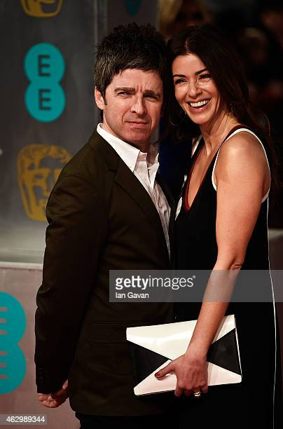 Noel Gallagher and Sara MacDonald attend the EE British Academy Film Awards at The Royal Opera House on February 8 2015 in London England