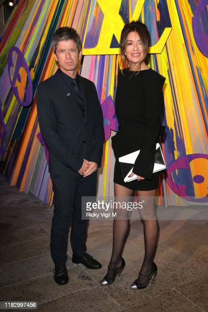 Noel Gallagher and Sara MacDonald seen attending Louis Vuitton Maison - store launch party on October 23, 2019 in London, England.