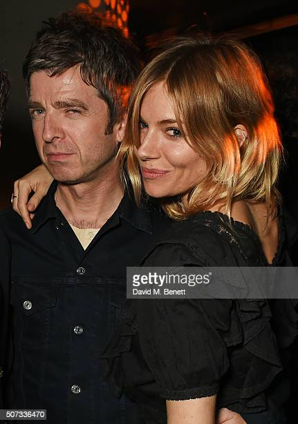 Noel Gallagher and Sienna Miller attend the launch of 100 Wardour St on January 28 2016 in London England
