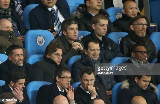 Noel Gallagher below him Jean Sarkozy attend the UEFA Champions League Round of 16 first leg match between Manchester City FC and AS Monaco at Etihad...
