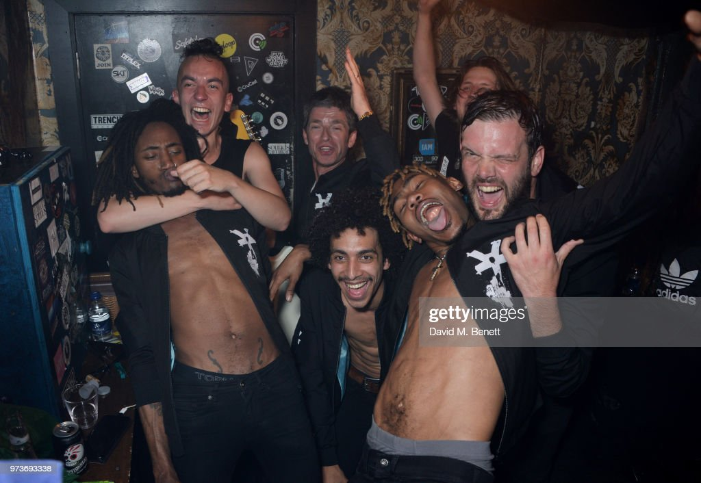 Noel Gallagher (3L) celebrates backstage with Seye Adelekan, Jeff Wootton, Twiggy Garcia, Jay Sharrock, Young Lazarus and Jamie Reynolds of YOTA following their performance at XOYO on June 13, 2018 in London, England.
