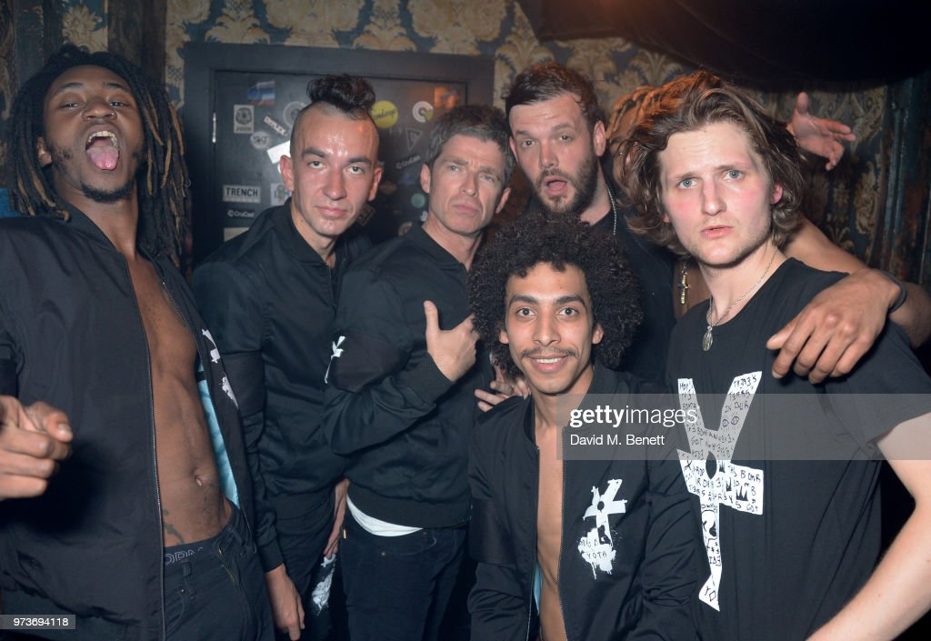Noel Gallagher (3L) celebrates backstage with Seye Adelekan, Jeff Wootton, Twiggy Garcia, Young Lazarus, Jamie Reynolds and Jay Sharrock of YOTA following their performance at XOYO on June 13, 2018 in London, England.