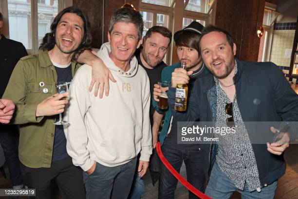 """Noel Gallagher meets a group of fans at the World Premiere of """"Oasis Knebworth 1996"""" at the Picturehouse Central on September 16, 2021 in London,..."""