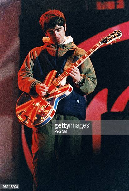 Noel Gallagher of Oasis performs on stage playing his iconic Union Jack Epiphone guitar at Maine Road Stadium on April 28th 1996 in his home town of...