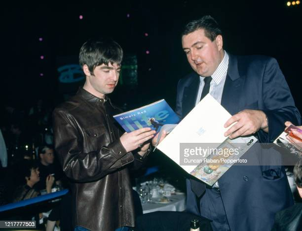 Noel Gallagher of Oasis signing autographs during the Brit Awards at Earls Court Exhibition Centre in London, England on February 19, 1996.