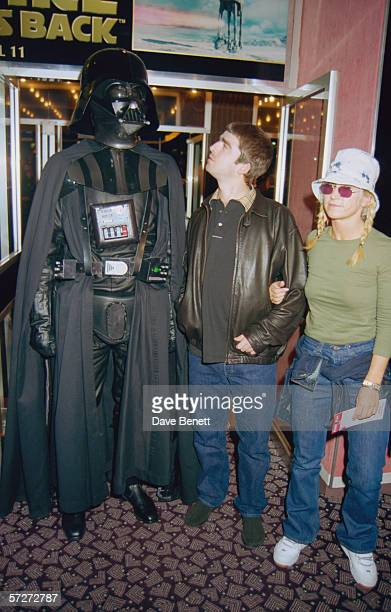 Noel Gallagher of rock group Oasis with his wife Meg Matthews with an actor in costume as Darth Vader at the premiere of the 'Star Wars' Special...