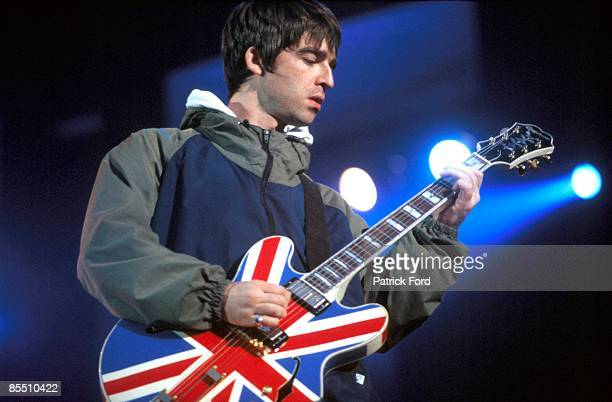 Photo of Noel GALLAGHER and BRITPOP and OASIS Noel Gallagher performing live onstage playing Epiphone Sheraton Union Jack guitar at Maine Road Britpop