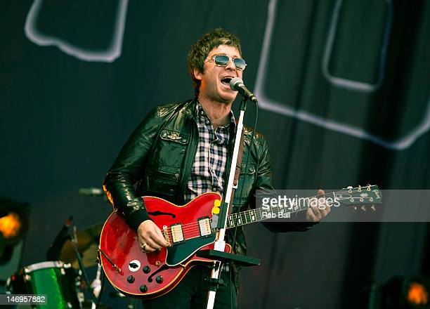 Noel Gallagher performs with Noel Gallagher's High Flying Birds perform at the Isle Of Wight Festival at Seaclose Park on June 24 2012 in Newport...