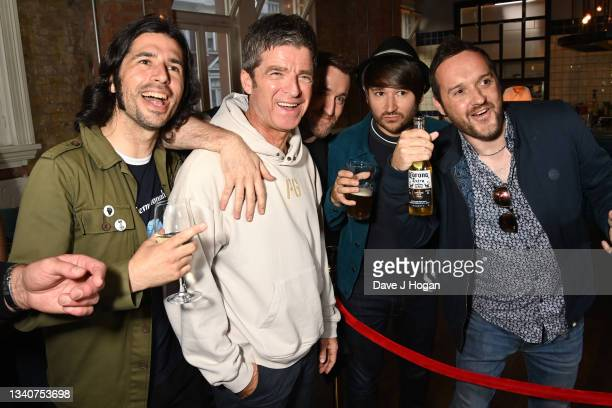 """Noel Gallagher poses with fans during the """"Oasis Knebworth 1996"""" World Premiere at Picturehouse Central on September 16, 2021 in London, England."""