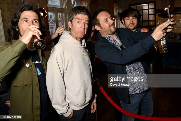 """Noel Gallagher reacts as he poses with fans during the """"Oasis Knebworth 1996"""" World Premiere at Picturehouse Central on September 16, 2021 in London,..."""